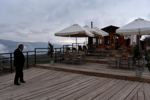 Juan standing on the deck of a ski resort restaurant