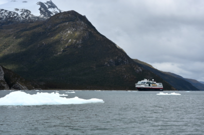 The Midnatsol holds anchor in the fjord