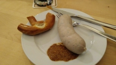 One of the sausages we made along with mustard and pretzels