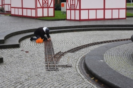 This guy lays train track getting ready for the Christmas Markets