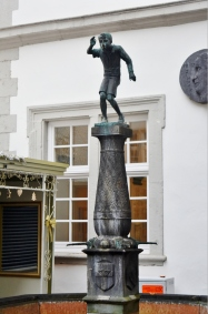 """This """"Spitting Boy"""" fountain has water flowing below, but every two minutes he spits water at anyone within range."""
