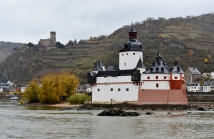 Sailing along the middle Rhine, we find many castles. Notice the one high on the hill and then this one on an island in the river. This one was used to collect tolls. A chain was stretched across the river . A toll was collected, the chain lowered to the bottom of the river, and then a boat could pass.