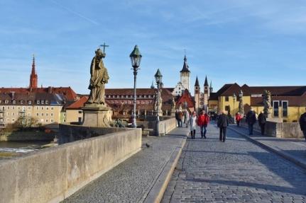 Walking the Old Stone Bridge into town