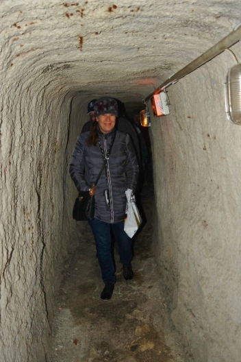 Terry makes her way through the tunnels in the Rock-cut Beer Cellars