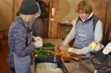 Lana and Carol cutting vegetables for the sausage