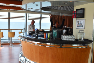 Deck 9 bar just inside the outdoor deck. Notice the bar set against the windows so you can enjoy the view while having a drink.